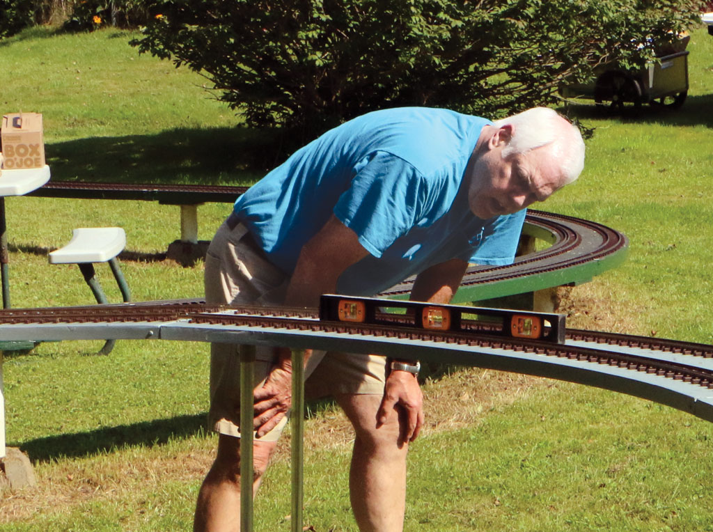 Tom Bowdler checks the level as he sets up his new portable track.